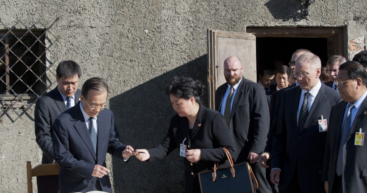 Prime Minister Wen signs a visitor's log book today after his visit to the Museum of Auschwitz in Oswiecim, southern Poland.</p>
