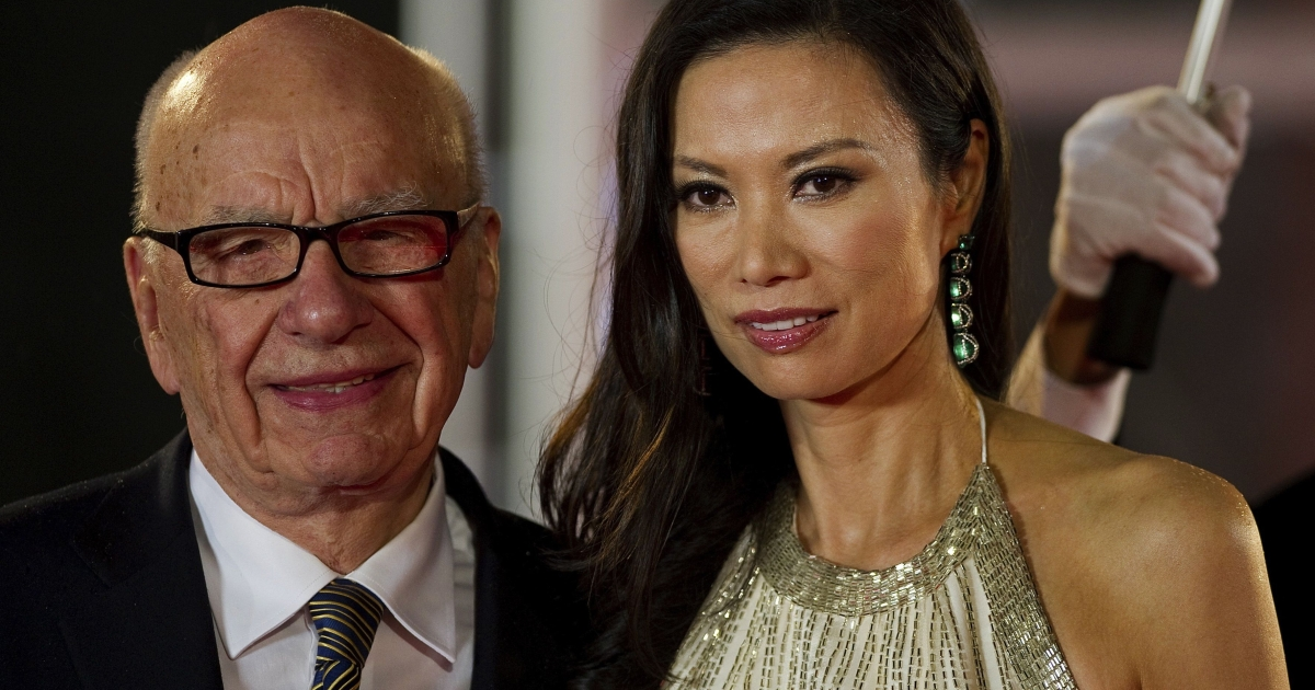 Rupert Murdoch and his wife Wendi Deng arrive on the red carpet during the opening ceremony of the Shanghai International Film Festival in Shanghai on June 11, 2011.</p>