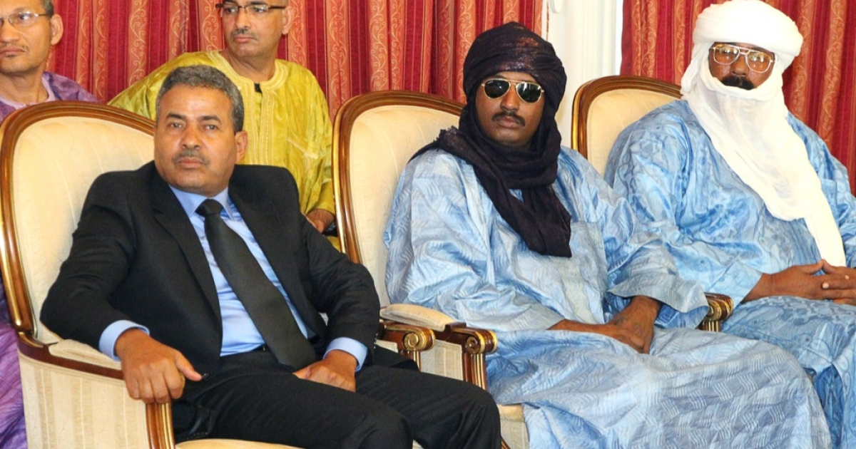 Unidentified representatives of Tuareg who returned to Mali after fighting in the Libyan army meet Mali's President at the presidential palace in Bamako on Dec. 3, 2011.</p>