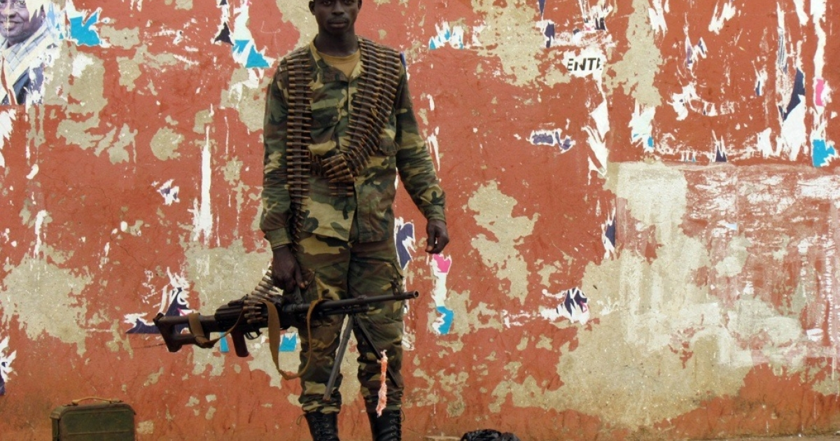 A Guinea-Bissau soldier stands guard in a street near the National Assembly on April 13, 2012 in the capital, Bissau.</p>