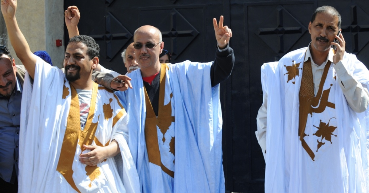 Three activists for the independence of Western Sahara, Ali Salem Tamek, left, Ibrahim Dahhane, right, and Ahmed Naciri, center, who were detained for more than two years on charges of undermining Morocco's internal security, celebrate after being released from prison, on April 14, 2011. The trial of the activists had been postponed several times since they were arrested in October 2009.</p>