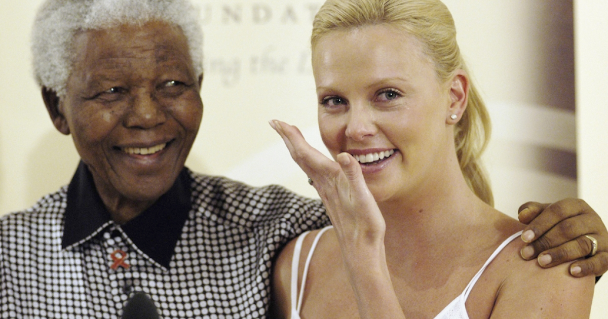 Oscar winning Actress Charlize Theron wipes away tears as she meets former South African President Nelson Mandela at Mandela House following her Academy Awards success, on March 11, 2004 in Johannesburg, South Africa.</p>