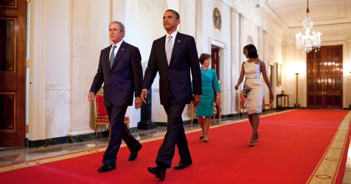 President Barack Obama and First Lady Michelle Obama walk with former President George W. Bush and former First Lady Laura Bush in the Cross Hall towards the East Room of the White House on May 31, 2012.</p>