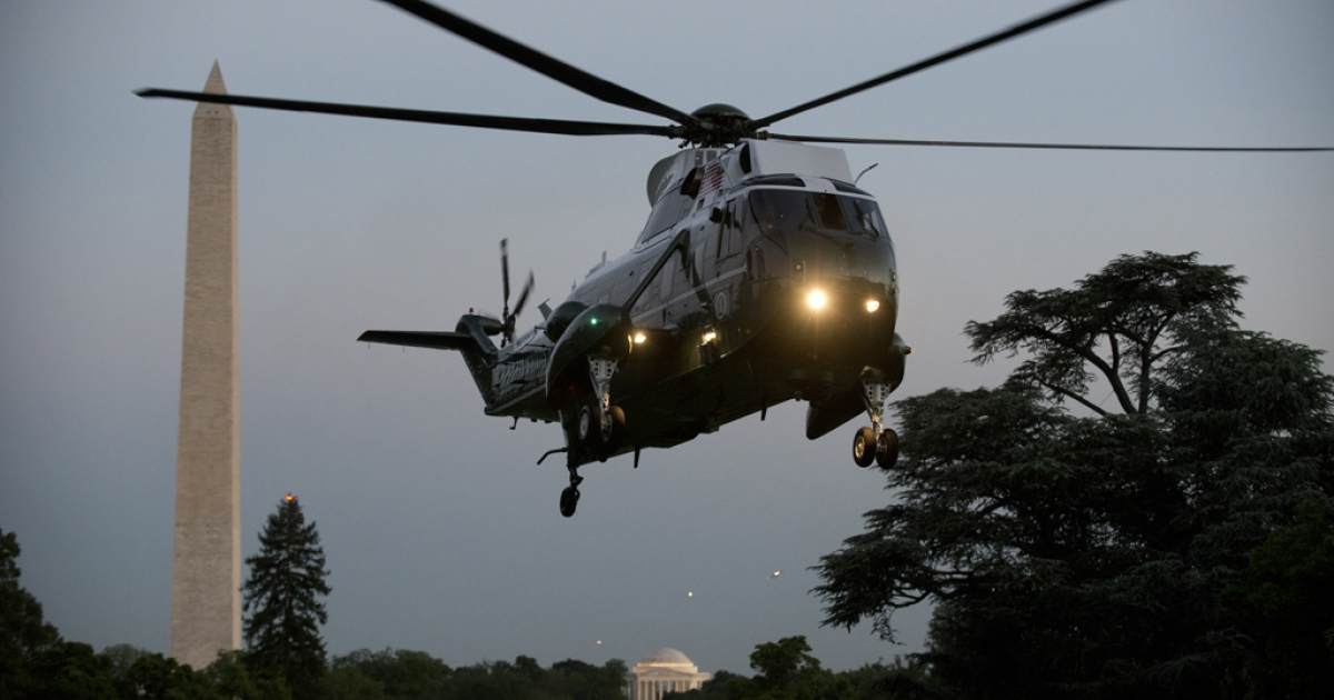 US President Barack Obama arrives onboard Marine One on the South Lawn of the White House May 11, 2012 in Washington, D.C.</p>