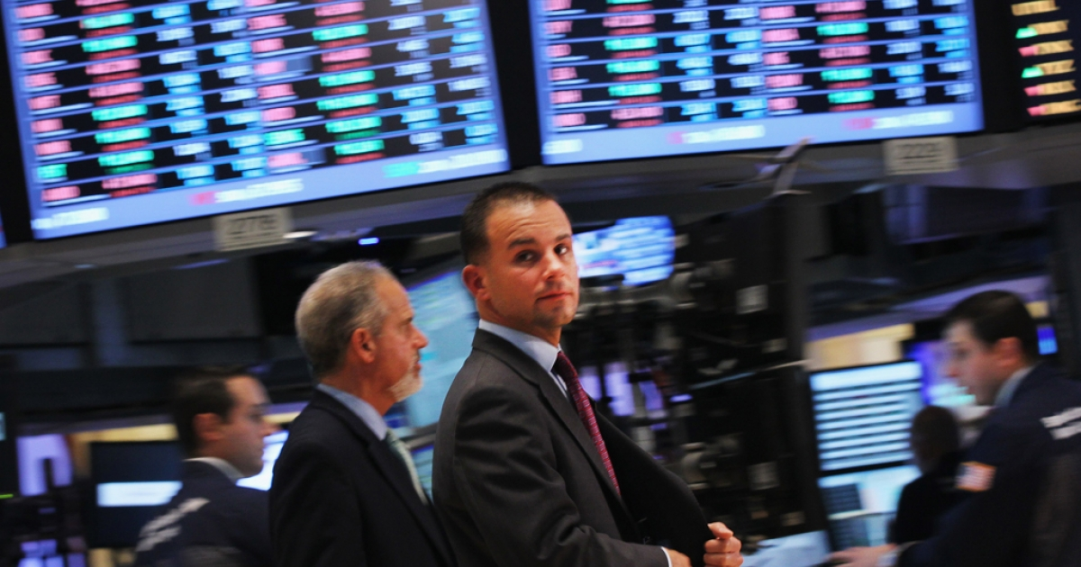 Traders work on the floor of the New York Stock Exchange before the closing bell on November 1, 2011 in New York City. Despite the fact that there are fewer white men in the racially diverse financial industry, they earn most of the money.</p>