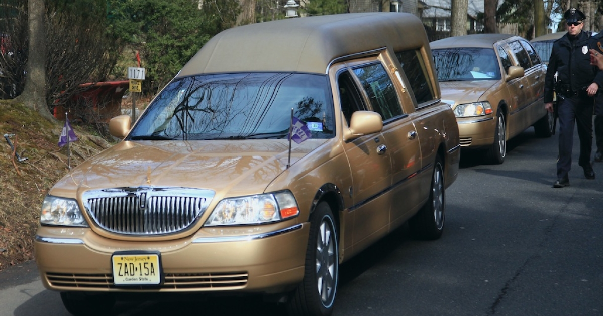 The hearse carrying the body of singer Whitney Houston arrives for her burial service at the Fairview Cemetery on February 19, 2012 in Westfield, New Jersey. Whitney Houston was found dead in her hotel room at The Beverly Hilton hotel on February 11, 2012.</p>