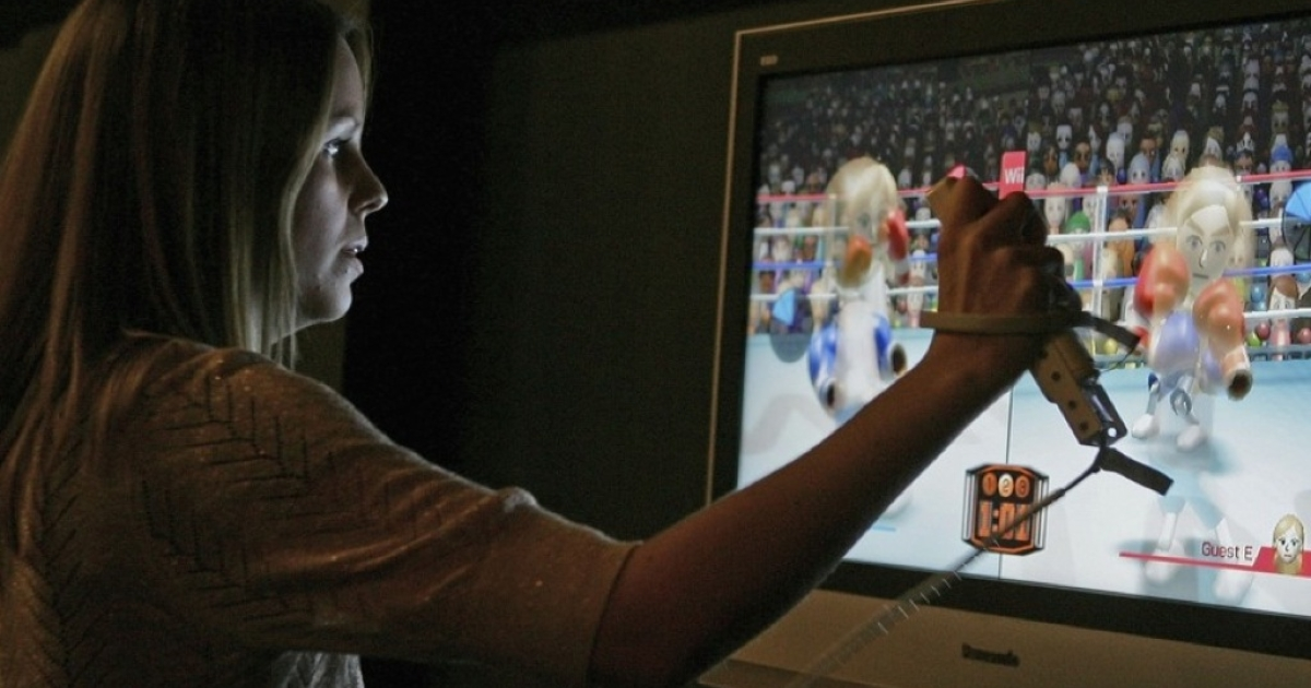 A woman uses a wireless controller to play a boxing game on a Nintendo Wii during the Game On exhibition at the Science Museum on November 29, 2006 in London, England.</p>