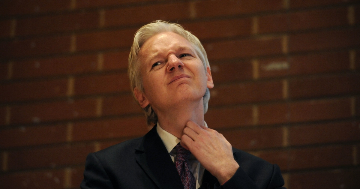 WikiLeaks founder Julian Assange attends a debate on the subject of whistle-blowing with prominent public figures on secrecy and transparency issues at Kensington Town hall in central London on April 9, 2011.</p>