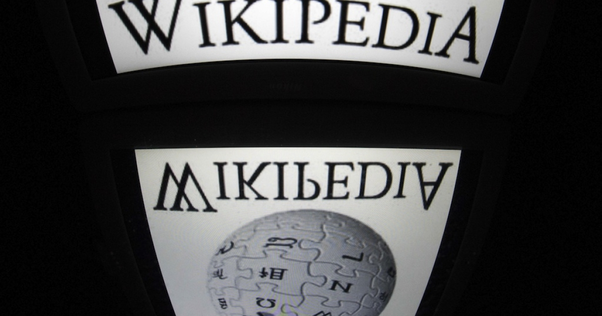 The 'Wikipedia' logo is seen on a tablet screen on December 4, 2012 in Paris.</p>