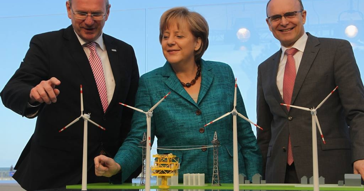 Germany vowed to focus on renewable energies like wind power instead of nuclear power, especially after the Fukishima disaster.  Angela Merkel is seen here in May 2011 with a model of Germany's first offshore windfarm in the Baltic Sea.</p>