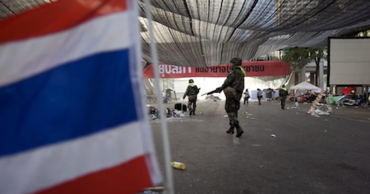 Thai soldiers clear out anti-government protesters' core Bangkok encampment in May 2010.</p>