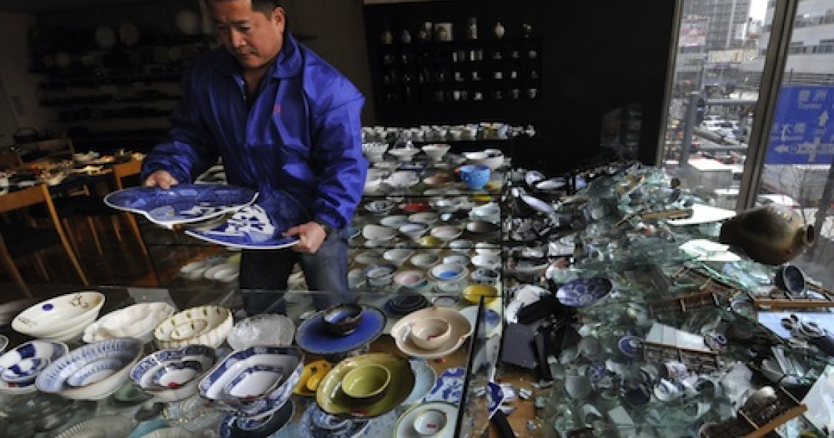 The owner of a ceramic shop checks his damaged wares following the massive 8.9-magnitude earthquake in Tokyo on March 11, 2011. The huge earthquake shook Japan, unleashing a powerful tsunami that sent ships crashing into the shore and carried cars through the streets of coastal towns.</p>