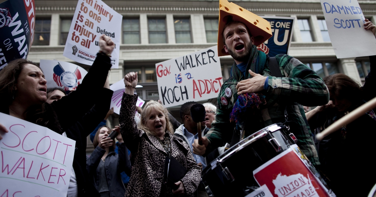 Activists protest outside a Wisconsin Republican fundraiser March 16, 2011</p>