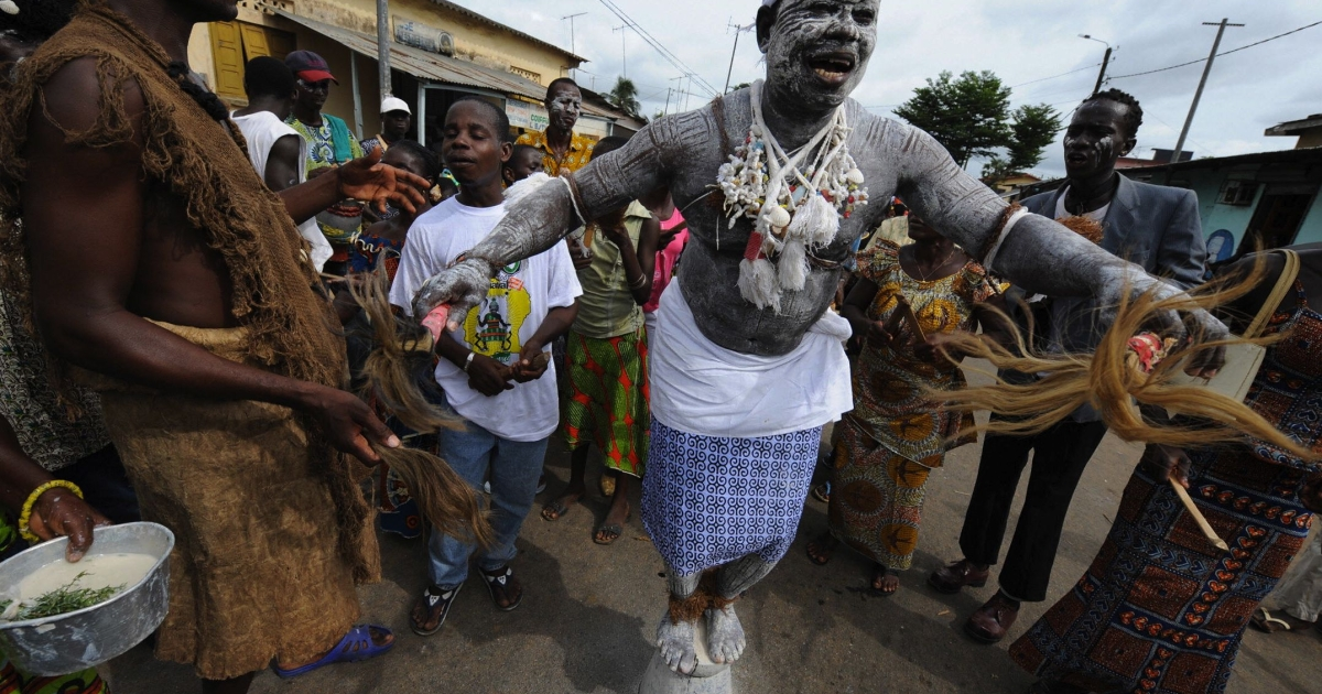 A witch-doctor stands on a pot on May 3, 2008 during the procession of the 30th Popo carnival of Bonoua, south of Abidjan.</p>