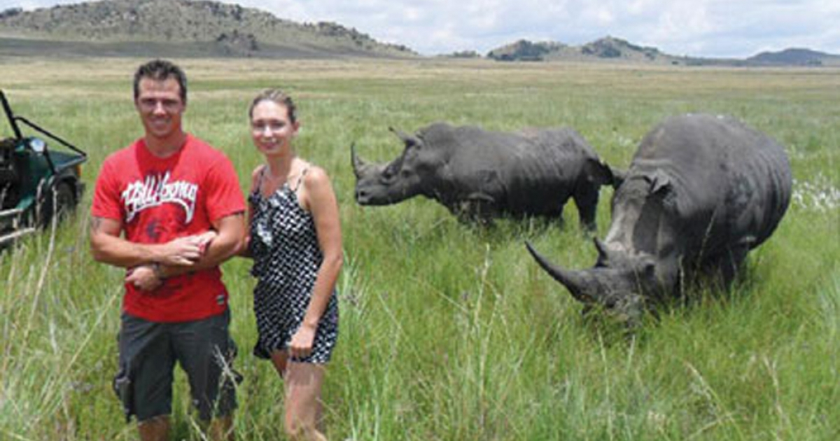 Chantal Beyer, 24, is pictured with her boyfriend moments before being gored by one of these rhinos in a South African game park.</p>
