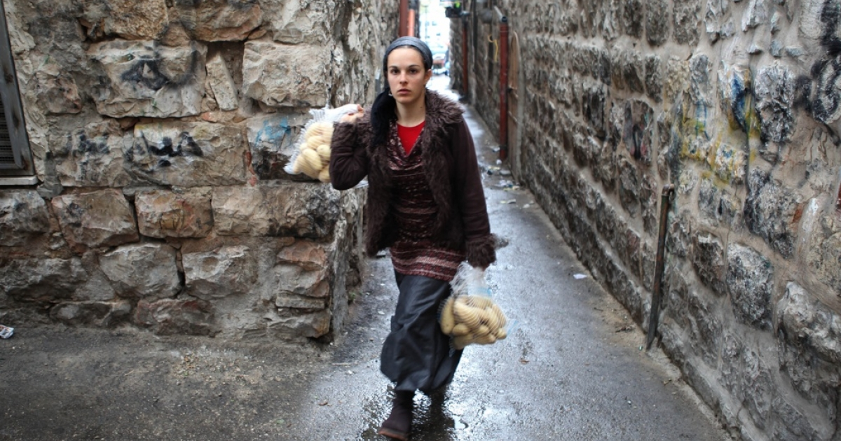 A Jewish Israeli woman carries her shopping in Jerusalem on Nov. 16, 2011. Women's rights in Israel, and their role in public, is being challenged by ultra-Orthodox Jews.</p>