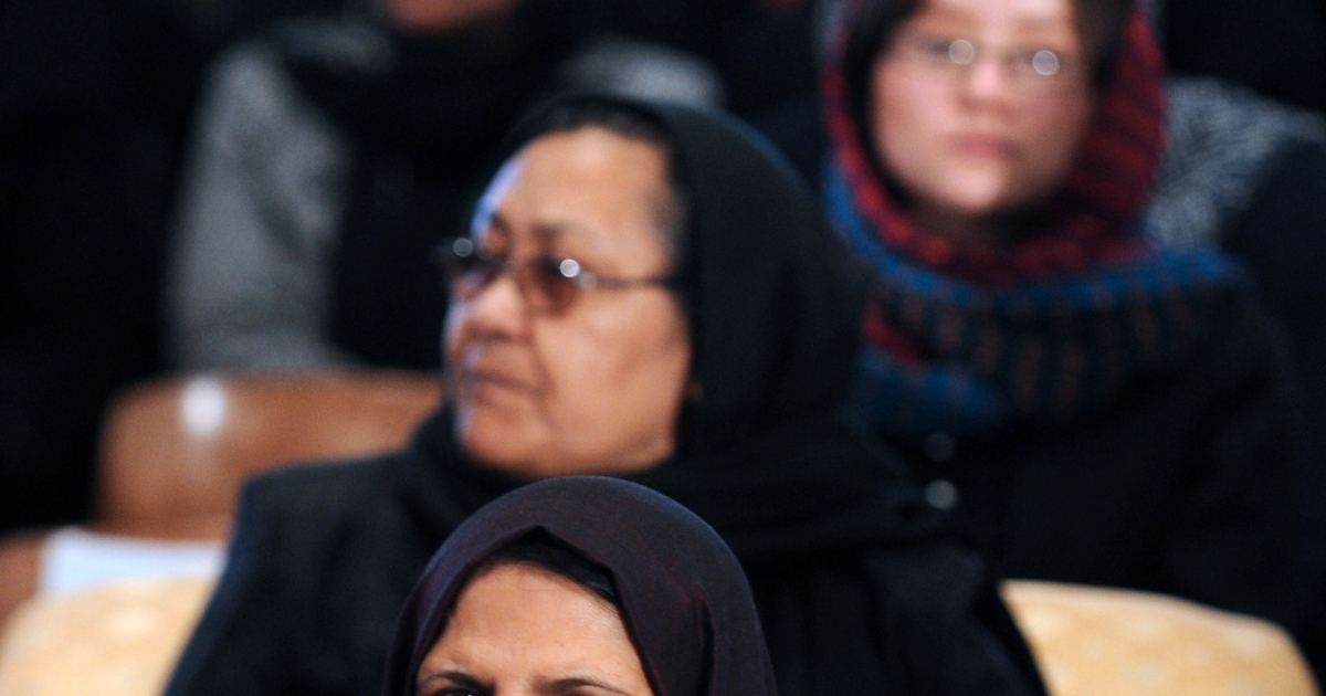 Women listen to President Hamid Karzai's speech on the occasion of International Women's Day, Kabul, March 8, 2011</p>