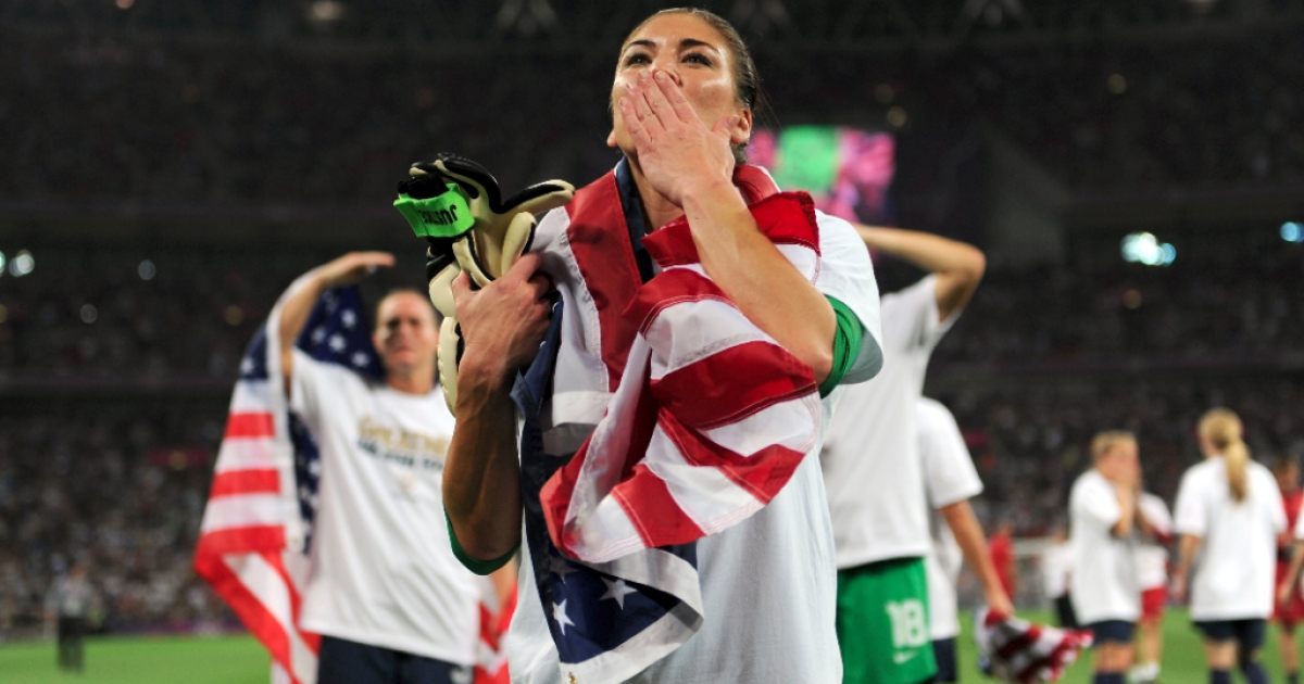 Hope Solo #1 of the United States celebrates with the American flag after defeating Japan by a score of 2-1 to win the Women's Football gold medal match on Day 13 of the London 2012 Olympic Games at Wembley Stadium on August 9, 2012 in London, England.</p>