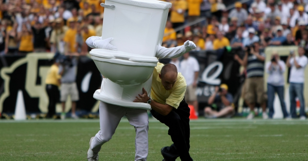A running toilet is stopped as part of a promotion by Denver Water during a break in the action at Invesco Field in Denver, Colorado. Sept. 1, 2007.</p>