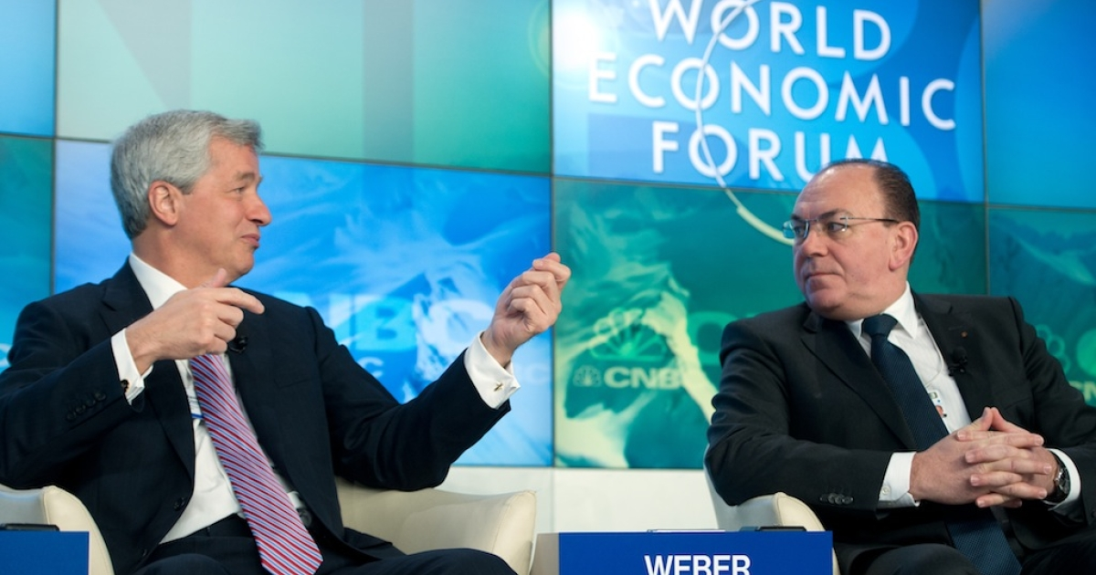 Swiss banking giant UBS board of director Chairman Axel A. Weber (R) listens to JP Morgan Chase chief executive officer Jamie Dimon on Jan. 23 in Davos.</p>