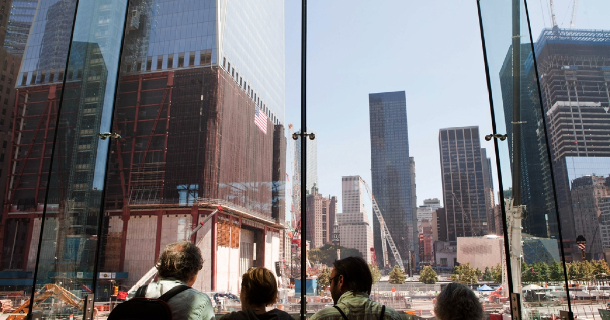People watch construction on the World Trade Center site from a viewing area at the World Financial Center on September 9, 2011 in New York City. The building was evacuated Thursday after a security guard found a fake grenade in a package.</p>