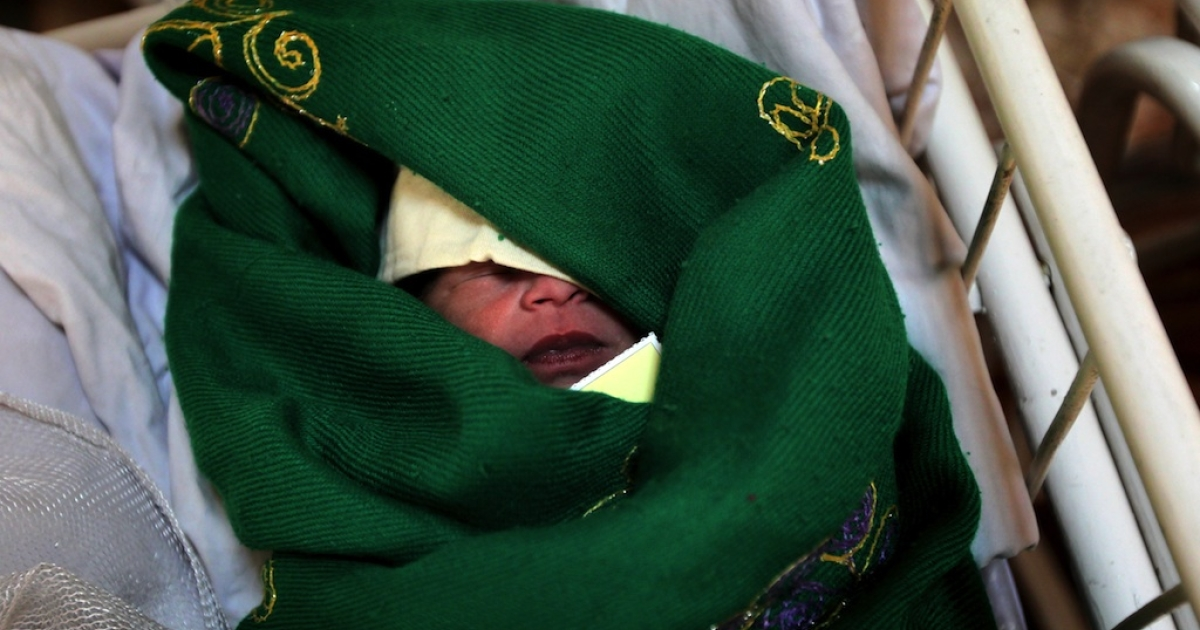 An Afghan newborn boy who was born earlier that morning sleeps in a cradle in the maternity ward of a hospital in Kabul on March 15, 2010.</p>