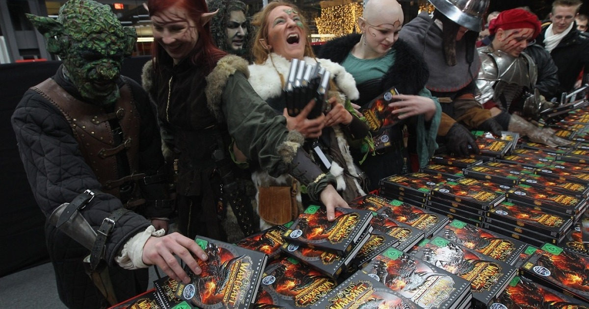 Employees of an event company dressed as characters from the 'World of Warcraft' video games, themselves also gaming enthusiasts, ham it up for observing media as they scoop up the new 'World of Warcraft: Cataclysm' game shortly after midnight at the game's sales premiere at MediaMarkt on December 7, 2010 in Berlin, Germany.</p>