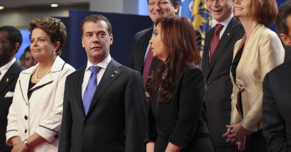 Dmitry Medvedev, Russia's president, speaks with Cristina Fernandez de Kirchner, Argentina's president, before the family photograph at the Group of 20 (G20) Cannes Summit at the Palais des Festivals on November 3, 2011 in Cannes, France.</p>