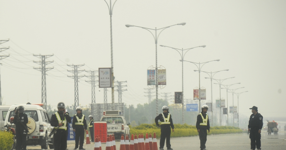 A police roadblock is placed enroute into Wukan, located in southern China. The village is surrounded by police after a land dispute sparked anger, and the death of a community leader prompted protests.</p>
