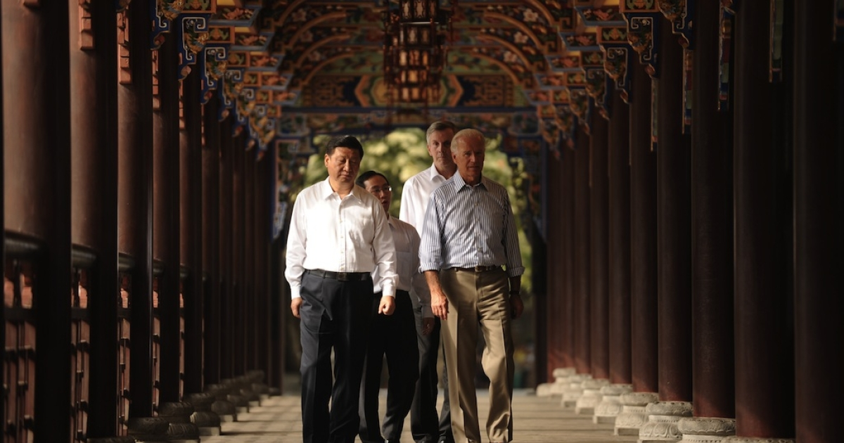 US Vice President Joe Biden (R) and Chinese Vice President Xi Jinping (L) accompanied by their translators walk across the Dujiangyan Irrigation system in Dujiangyan outside Chengdu in China's southwest province of Sichuan on August 21, 2011. Biden said that the world's biggest economy has never defaulted on its debt and never would, during a visit aimed at boosting Chinese confidence in the US economy.</p>