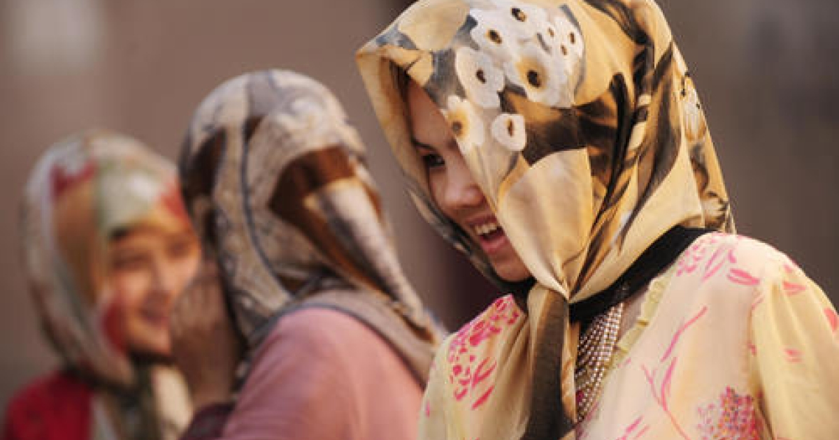 Ethnic Uighur women shop in the market in the old city of Kashgar in China's Xinjiang region on July 10, 2009.  With a boom that has failed to share the wealth, cultural misunderstandings and historical resentment, the anger of Xinjiang's Uighur Muslims is deep-set.</p>