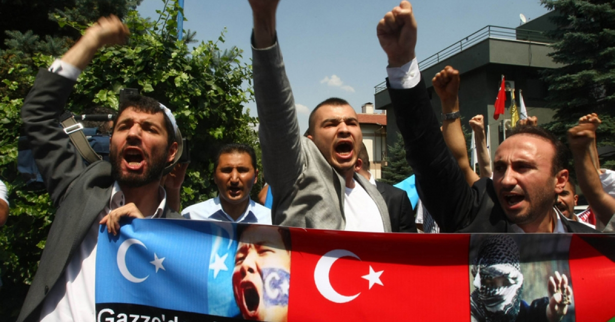 Uighurs living in Turkey demonstrate outside the Chinese embassy in Ankara on July 22, 2011 to protest against alleged Chinese brutality against members of the Chinese Muslim Uighur minority in China's far-western Xinjiang Region.</p>