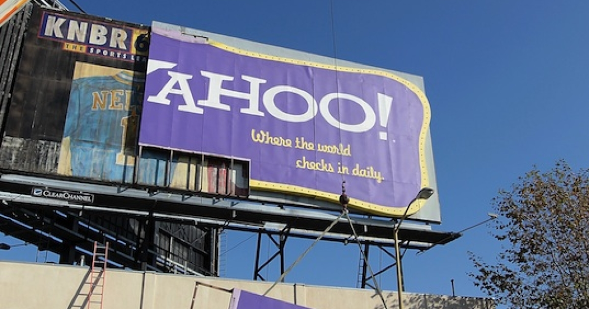 Workers use a crane to move a section of a Yahoo! billboard onto a truck on December 21, 2011 in San Francisco, California.</p>