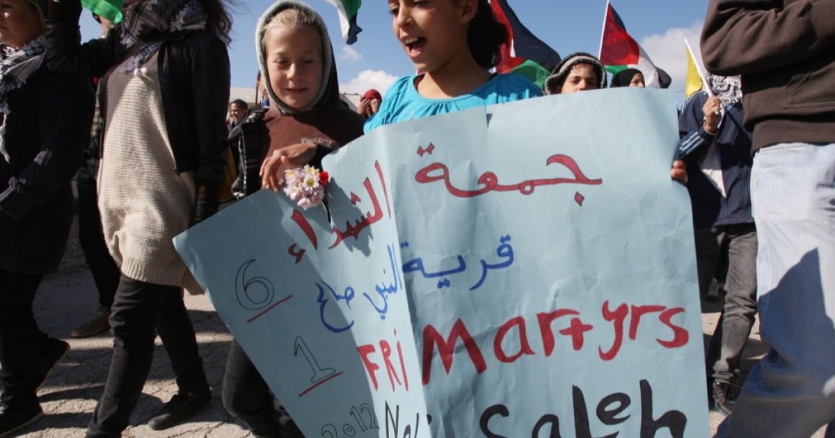YaLa Young Leaders are rising up. Here, two young Palestinian girls take part in a weekly demonstration against the construction and expansion of Israeli settlements on village lands in the West Bank village of Nabi Saleh, near Ramallah, on Jan. 6, 2012.</p>