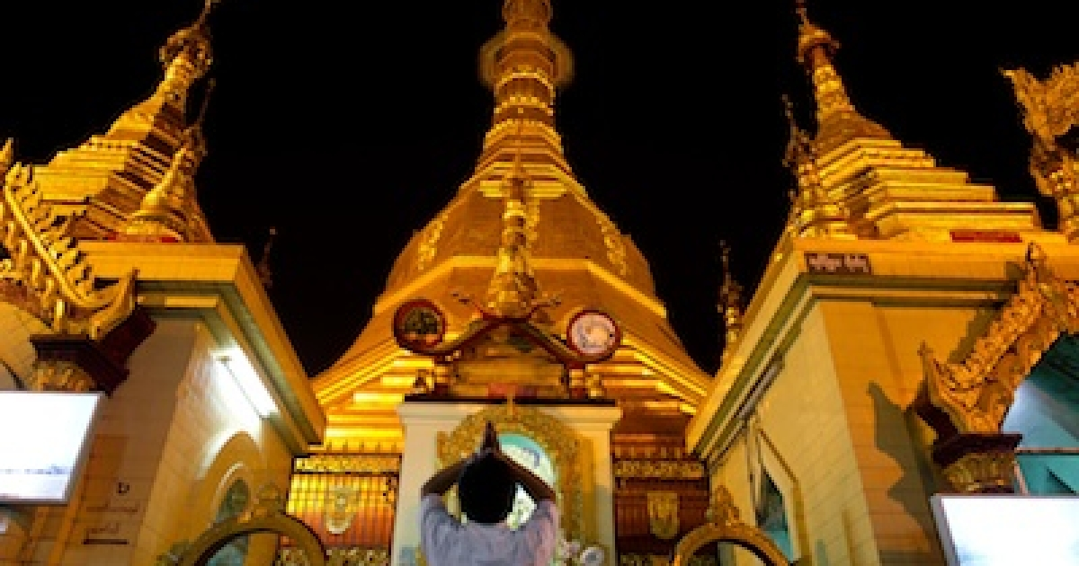 A man prays at Sule Pagoda in downtown Yangon, Myanmar's commercial capital, on Feb. 16, 2012.</p>