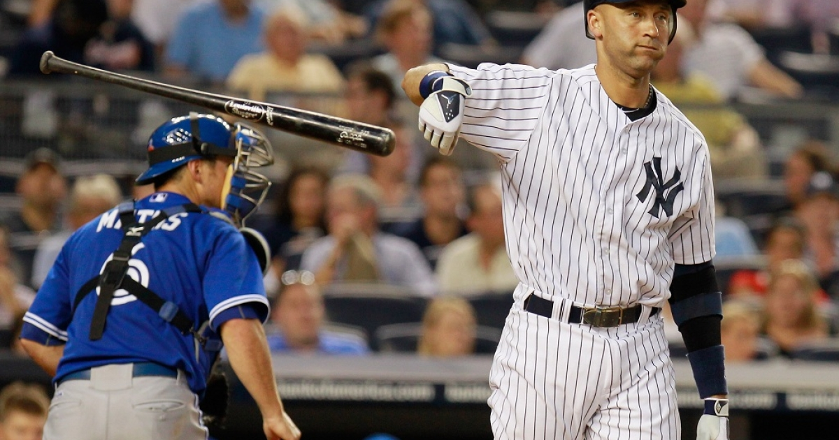 Derek Jeter #2 of the New York Yankees throws his bat after striking out to end the fourth-inning against the Toronto Blue Jays at Yankee Stadium on July 17, 2012 in the Bronx borough of New York City.</p>