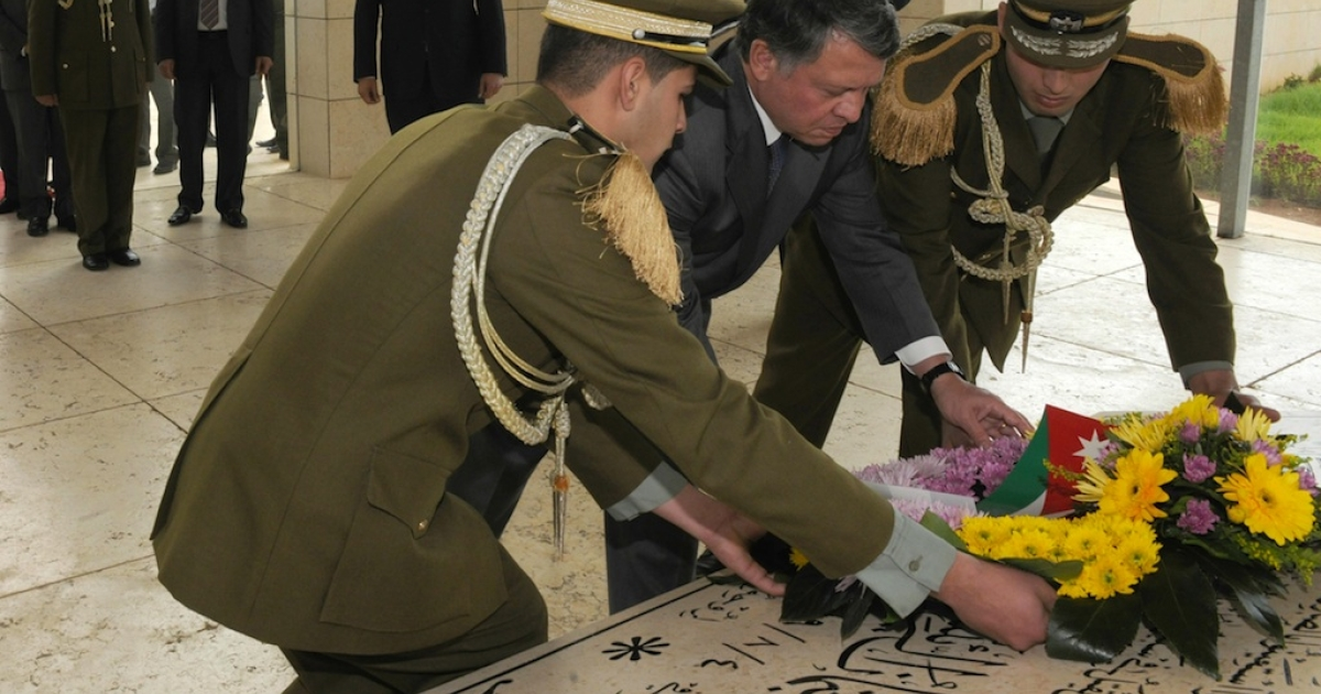 In this handout image provided by the Palestinian Press Office (PPO), Palestinian President Mahmoud Abbas (Abu Mazen) (centre L) and King Abdullah II of Jordan (center R) lay a wreath at the tomb of the late President Yasser Arafat on November 21, 2011 in Ramallah, West Bank. Arafat's body is set to be exhumed and re-examined at the end of November.</p>