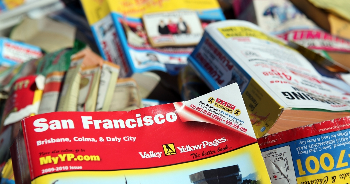 A pile of phone books sits in the back of a pickup truck during a press conference in San Francisco, Calif., on Feb. 1, 2011. In May 2011, San Francisco banned unsolicited Yellow Pages phone books from being dropped off at consumer's homes and offices.</p>