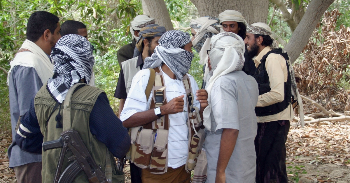 An image taken on January 21, 2012, shows militants loyal to Jalal al-Blaidy, leader of the Ansar al-Sharia, gathered in a valley in the vicinity of Zinjibar, the provincial capital of Abyan.</p>