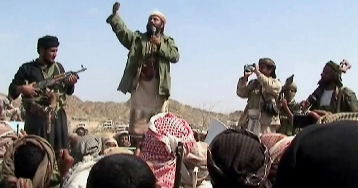 A man claiming to be an Al-Qaeda member addresses a crowd gathered in Yemen's southern province of Abyan</p>