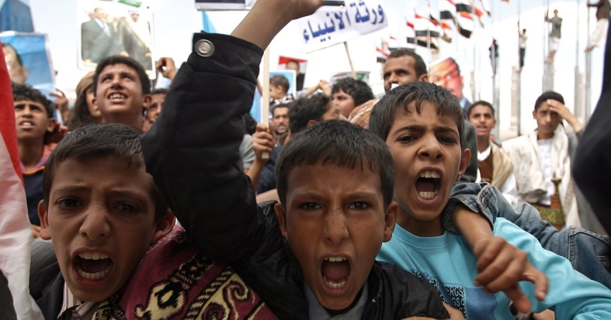 Yemeni boys shout slogans as they attend a pro-regime rally in Sanaa on September 30, 2011, after a U.S. drone strike in Yemen killed Al Qaeda agent Anwar al-Awlaki, who had dual American and Yemini citizenship.</p>