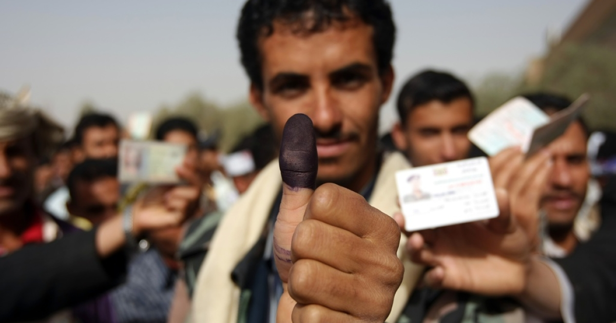 A Yemeni man shows his ink-stained thumb after voting in Yemen's presidential election in Sanaa on Feb. 21, 2012.</p>