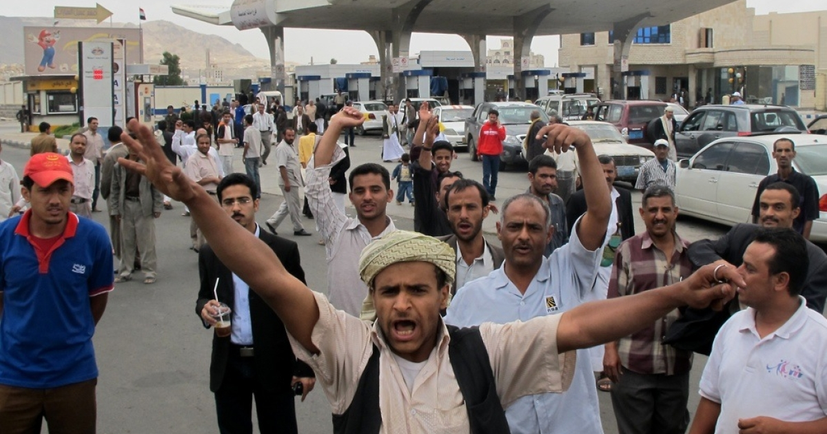 Yemenis shout slogans at a petrol station amid a fuel shortage in the Yemeni capital of Sanaa on May 5, 2011.</p>