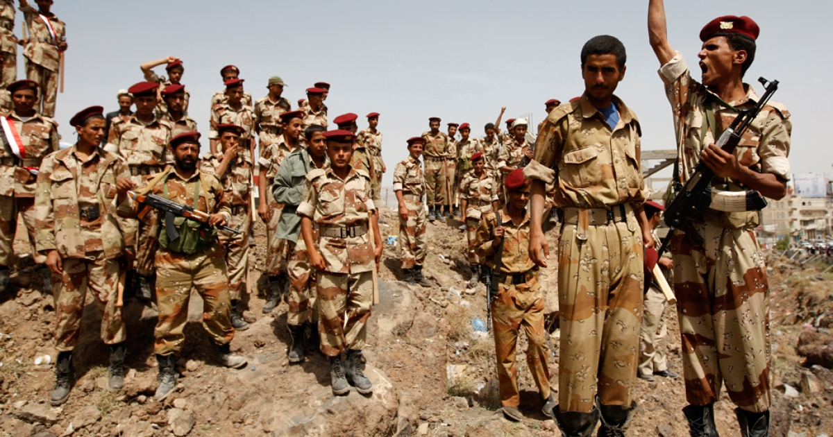 A Yemeni soldier shouts slogans as others who joined sides with anti-regime protesters gather, during a demonstration demanding the resignation of Yemeni President Ali Abdullah Saleh, in Sanaa on June 10, 2011.</p>