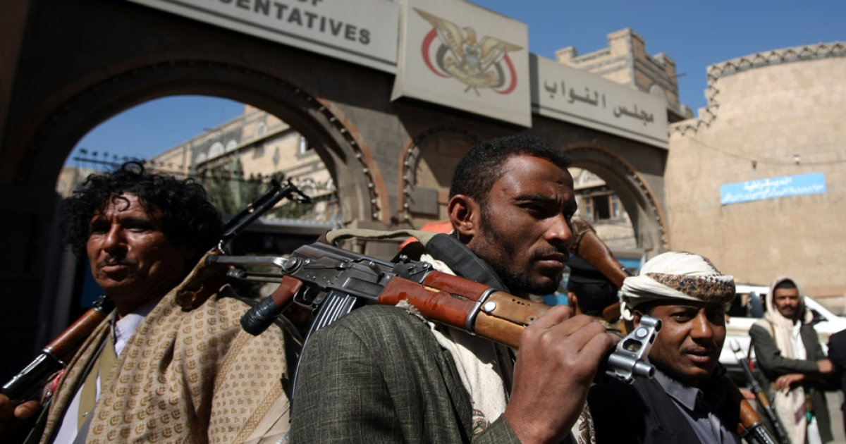 Yemeni armed tribesmen who are the bodyguards of members of the parliament stand outside the House of Representatives (parliament) in Sanaa on January 11, 2012.</p>