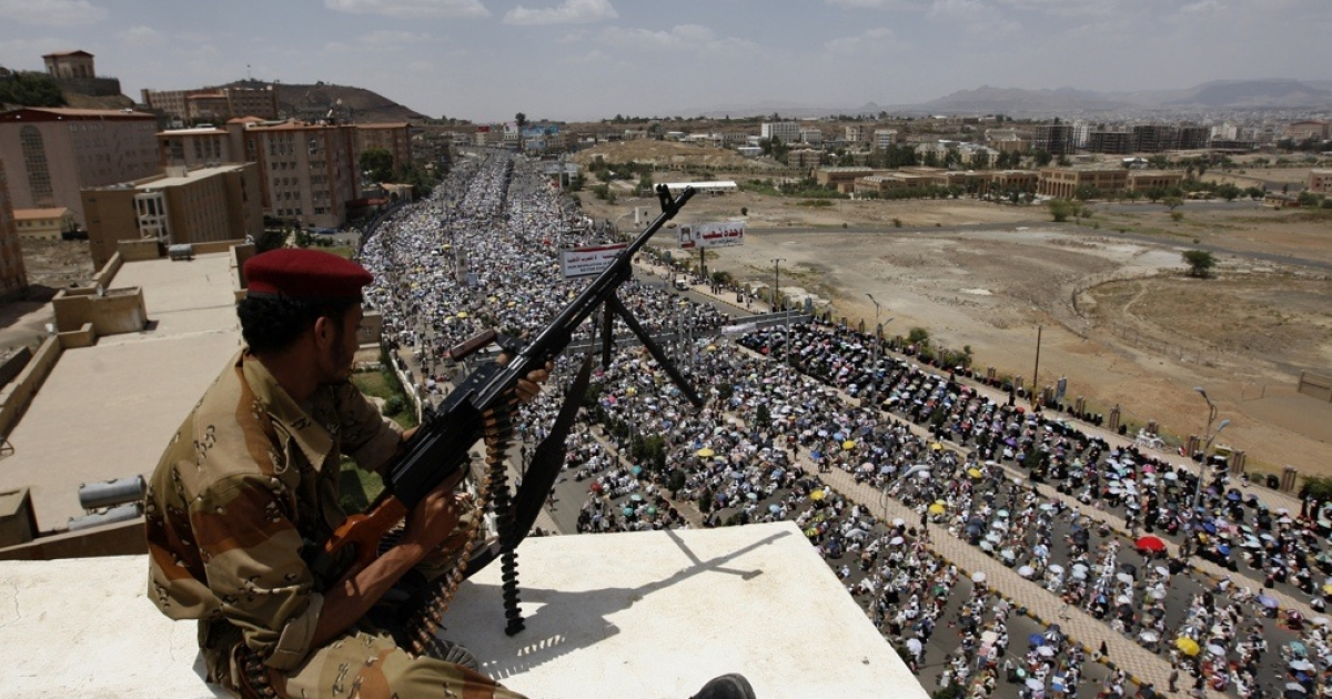 A Yemeni army soldier monitors a demonstration by tens of thousands of anti-regime protesters in central Sanaa on June 3, 2011.</p>