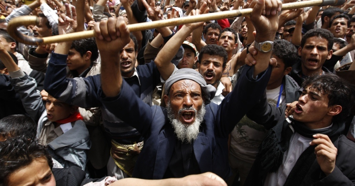 Yemeni anti-government protesters shout slogans during a demonstration calling for the ouster of President Ali Abdullah Saleh in Sanaa on March 30, 2011 as Saleh faces a popular uprising since the end of January, calling for an end to his 32-year rule.</p>