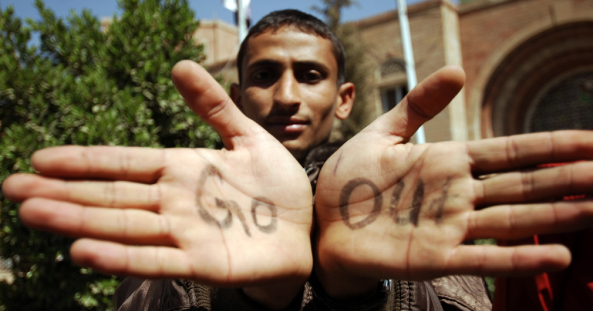 An anti-regime protester shows the palms of his hands as he and others gather inside the grounds of the Sanaa University in the Yemeni capital on Feb. 16, 2011, on the fifth day of consecutive protests against the regime of Yemeni President Ali Abdullah Saleh.</p>