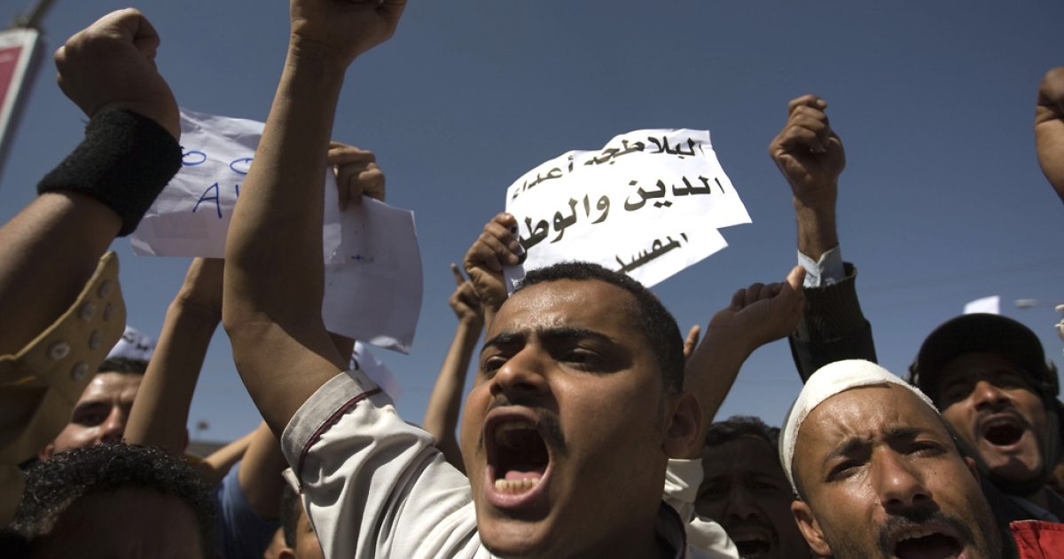 Yemeni anti-government demonstrators call for the ouster of President Ali Abdullah Saleh during a protest in Sanaa. For the first time, police opened fire on protesters outside Sanaa University, wounding four and one remains in critical condition.</p>