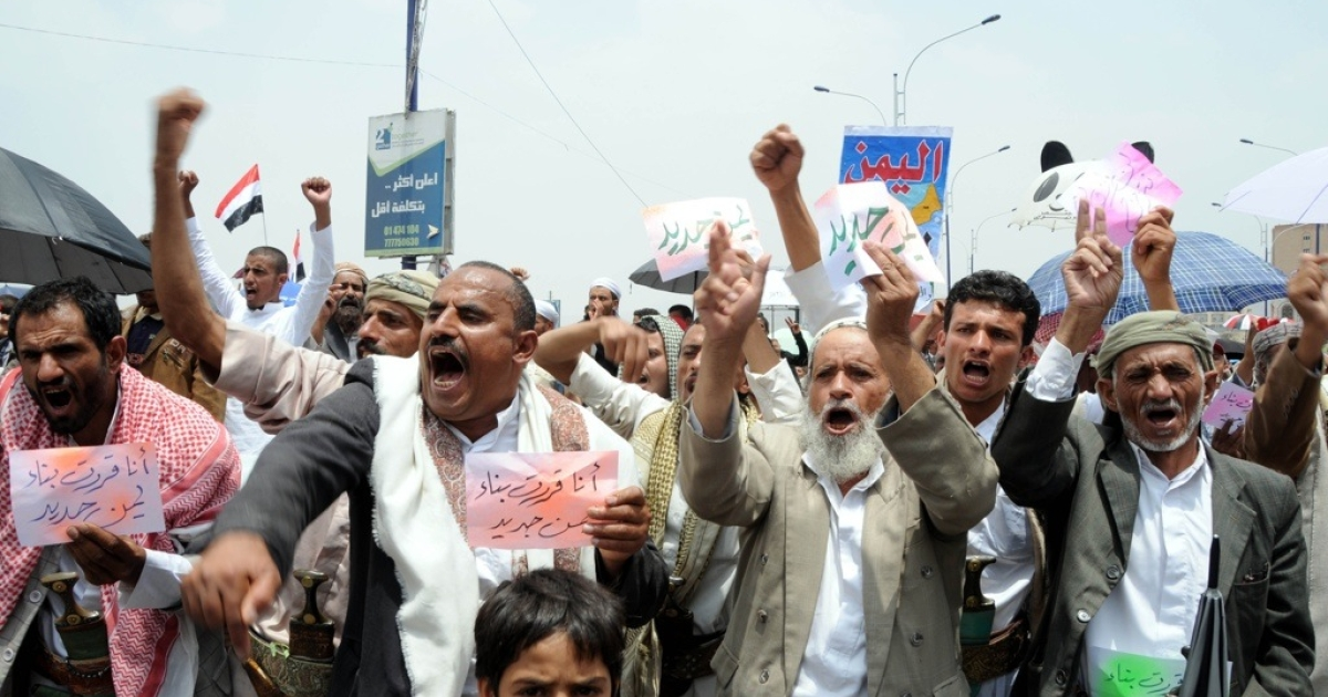 Yemeni anti-government protesters shout slogans against the rumored return of President Ali Abdullah Saleh during a demonstration in Sanaa on July 1, 2011.</p>